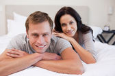 Couple relaxing on the bed together — Stock Photo