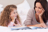 Mother reading a bedtime story for her daughter — Stock Photo