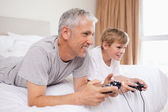 Happy father and his son playing video games — Stock Photo