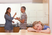 Sad little girl listening her parents having an argument — Stock Photo