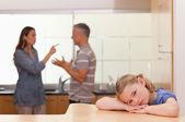 Sad little girl listening her parents having an argument — Stock Photo