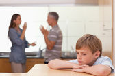 Sad little boy hearing his parents having am argument — Stock Photo
