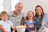 Family watching a movie — Stock Photo