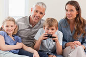 Charming family playing video games — Stock Photo