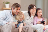 Competitive family playing video games — Stock Photo