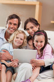 Portrait of a family using a tablet computer — Stock Photo