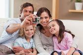Father taking a picture of his family — Stock Photo