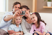 Happy father taking a picture of his family — Stock Photo