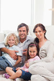 Portrait of a family relaxing on a sofa — Stock Photo