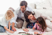 Beautiful family drawing together — Stock Photo