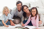 Charming family drawing together — Stock Photo