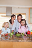 Portrait of a family preparing a salad — Stock Photo