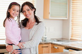Girl and her mother posing — Stock Photo