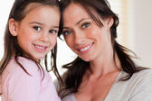 Close up of a girl and her mother — Stock Photo