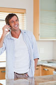 Portrait of a smiling man making a phone call — Stock Photo
