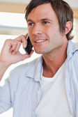 Portrait of a good looking man making a phone call — Stock Photo
