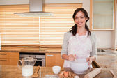 Smiling woman baking — Stock Photo