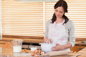 Happy woman baking — Stock Photo