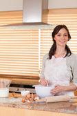 Portrait of a beautiful woman baking — Stock Photo
