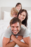 Portrait of a playful family lying on each other — Stock Photo