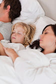 Portrait of a boy sleeping between his parents — Stock Photo