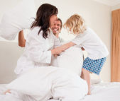 Cheerful family having pillow fight — Foto Stock