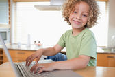 Boy using a laptop — Foto Stock