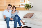 Couple sitting on a sofa — Stock Photo