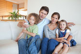 Family watching TV together — Stock Photo