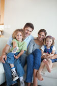 Portrait of a happy family watching TV together — Stock Photo