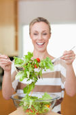 Salad being stirred by woman — Stock Photo