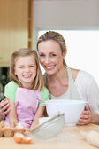 Mother and daughter having good time in the kitchen — Stock Photo
