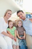 Man taking family picture on couch — Stock Photo