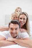 Playful family on the bed — Stock Photo