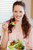 Girl eating salad — Stock Photo