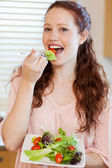 Girl having salad — Stock Photo