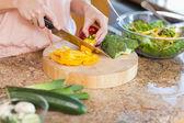 Woman preparing healthy salad — Stock Photo