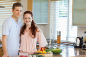 Couple standing behind kitchen counter — Stock Photo