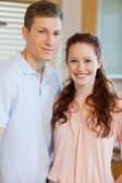Couple standing in the kitchen — Stock Photo