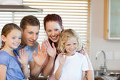 Family waving with their hands — Stock Photo