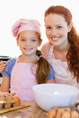 Mother and daughter with ingredients for cookies — Stock Photo