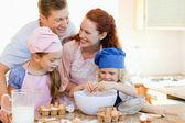 Happy family enjoys baking together — Stock Photo