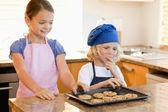 Siblings stealing cookies — Stock Photo