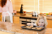 Boy stealing a cookie while his mother is not watching — Stock Photo