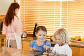 Siblings stealing cookies together — Stock Photo