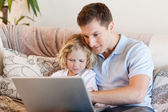 Father and son surfing the internet — Stok fotoğraf