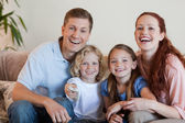 Family watching a funny movie — Stock Photo