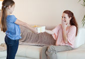 Daughter surprises her mother with a gift — Stock Photo