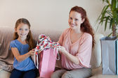 Mother and daughter with shopping — Stock Photo