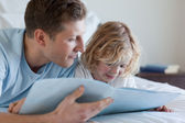 Father and son reading — Stock Photo